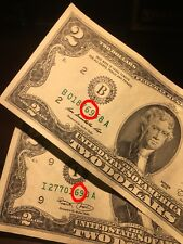 TWO TWO DOLLAR BILLS WITH 69 IN THE SERIAL NUMBER