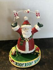 Mary Engelbreit Santa on a Ho!Ho!Ho! stand with arms holding arc/candies