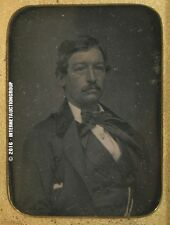 DAGUERREOTYPE OF MAN WITH LARGE BOW TIE BY MATHEW BRADY ON VELVET & IN CASE