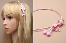 Narrow pink aliceband with doll motif. - JTY735