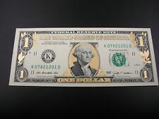 One Uncirculated Colorized Gold One Dollar Bill