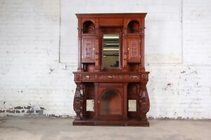 19th Century Ornate French Oak Sideboard Hutch or Bar Cabinet With Carved Faces