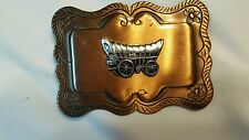 Mans western belt buckle covered wagon