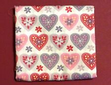 fat quarter of cotton poplin with large fancy pink and grey hearts on white