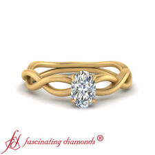 Solitaire Infinity Twist Engagement Ring With Oval Shape Diamond Center 0.50 Ctw