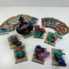BAKUGAN LOT OF 13 FIGURES WITH 35 Plus Magnetic Cards