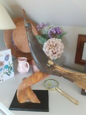 Vintage Hand Carved Horn Bird on twisted Horn Stand