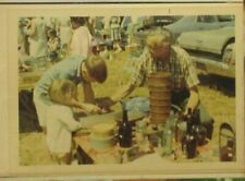 4 snapshots of Antiques Flea Market at Cooperstown New York dated July 1969