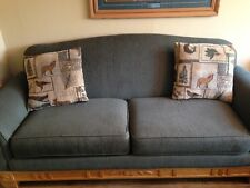 Schweiger couch and over sized chair. Outdoor themed, 2 cushions for each.