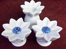 WHITE AND BLUE DAISY SALT AND PEPPER SHAKES WITH A MATCHING WHITE CANDLE HOLDER
