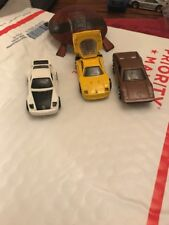Hot Wheels Ferrari 308 brown and Porsche and one other back opens