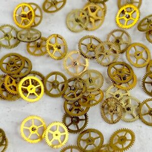 25 Gold Watch Wheels 4mm Tiny altered art parts Gears steampunk watchmaker lot