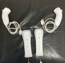 2 Wii Controllers, and 2 Nunchucks ** WORKING**