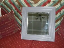An attractive square pine framed mirror with bevilled edges.