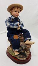 Porcelain Clothtique Fabric Mache Boy & Dog Sitting on Rocks eating Wood Base