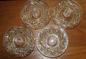 VINTAGE FOUR PRESSED GLASS CANDLE STICK HOLDERS.