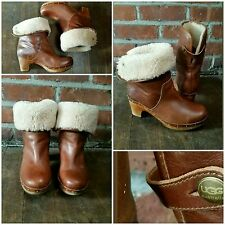 Women's brown Ugg clog booties with shearling lining, size 7