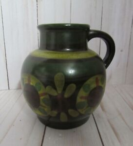 PITCHER, POTTERY, SMALL,4 1/2 INCHES TALL, DEEP GREEN & YELLOW GLAZE, W. GERMANY
