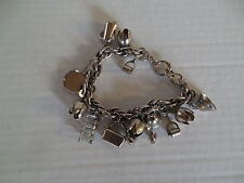 Vintage silver tone charm bracelet with 15 charms