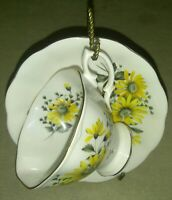 ROYAL ALBERT BONE CHINA MADE IN ENGLAND YELLOW FLORAL TEACUP AND SAUCER vintage