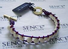 SENCE COPENHAGEN Perlenarmband mit weissen Hornperlen, Leder Einfassung purple