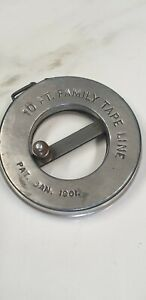 antique metal sewing family 10 ft tape measure