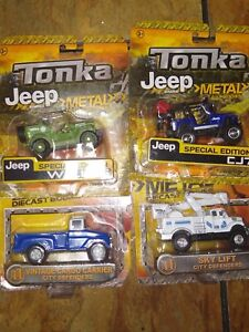 Lot of 4 Tonka Metal Trucks Diecast New. All four included in the price