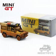 MINI GT 1:64 Land Rover Defender 110 1989 Camel Trophy Winner Dirty Version RHD