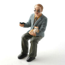 Dolls House Doll: Resin Sitting Figure of Man with a Kitten   in 12th scale