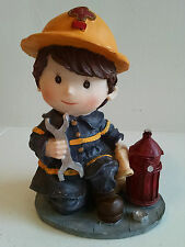 Fire Fighter Little Boy with Fire Hose, Hydrant, and Wrench Figurine