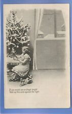 VINTAGE POSTCARD GIRL TOYS HOLD TO LIGHT SEE AN ANGEL CHRISTMAS XMAS GREETINGS