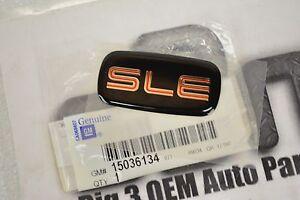 1997-2001 GMC Sierra Body Side Chrome/Black/Red SLE  EMBLEM new OEM 15036134