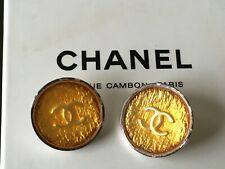 Chanel two silver gold CC 20mm cuff buttons