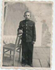1940s Handsome teen boy cadet uniform w/ chair child arcade odd Russian photo