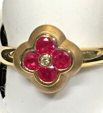 LADIES RUBY + DIAMOND RING/4 ROUND SHAPED STONES