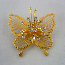 Signed Monet gold tone openwork metal butterfly rhinestone accents brooch
