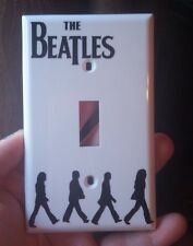 The Beatles inspired black and white light switch cover