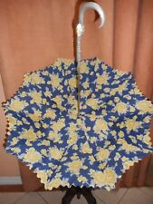 A VICTORIAN UMBRELLA  W/ AN ORNATELY DESIGNED  CROOK  HANDLE