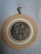 Antique old inside silver and outside plastic pendant with angel religious