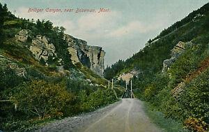 BRIDGER CANYON, NEAR BOZEMAN, MONT. MT. ENTRANCE. BRIDGE. DIRT ROAD.