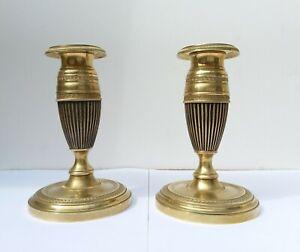Paire de bougeoirs style Empire en bronze doré et patine, fin 19 eme s