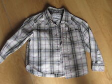 chemise  ML OKAIDI 4ans excellent état