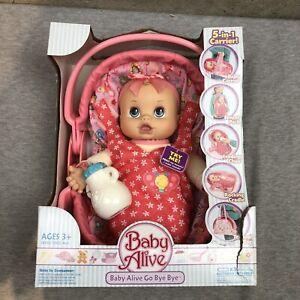NEW Hasbro 2008 Baby Alive Baby Go Bye Bye NIB Baby Carrier & Bottle Blue Eyes