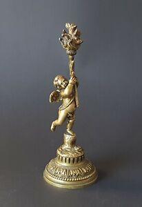 Superbe sujet en bronze doré figurant un putto portant une torche, fin XIX ème s