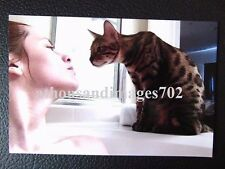 Nice Photo Of Pretty Lady In Bath Looking Up At Her Spotted Cat With Love
