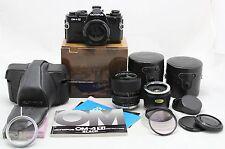 Olympus OM-4 Ti black vintage SLR camera & Zuiko lens Auto Zoom 35-70mm & extras