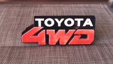 TOYOTA 1980's TERCEL L20 4WD GENUINE 'TOYOTA 4WD' GRILL BADGE!! P.N.75311-16130