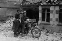 Canadian military police sergeant shows the way to a motorcyclist WW2 photo #245