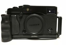 Fujifilm X-Pro1 16.3 MP Digital Camera Black Body with plate and thumbs up
