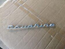 Renault Dauphine badge.  NOS.